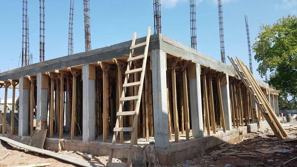 Striking of deck slab formwork in progress at the terminal
